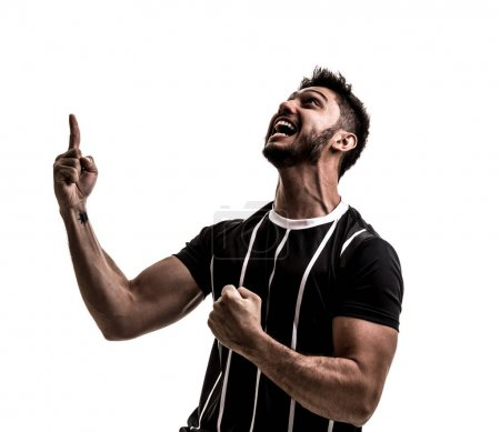 excited sportsman in striped black uniform celebrating on white background. Isolated view of cheerful male fan