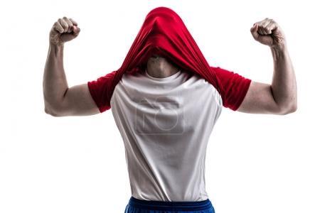 Fan / Sport Player on red uniform celebrating