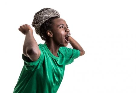 afro female fan celebrating in green uniform on white background