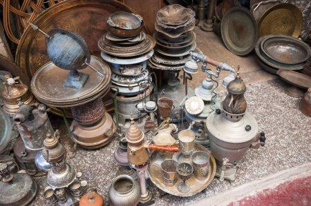Old kitchenware (trays, teapots, coffee turks, samovars, pans, plates, cups etc) at the flea market in Jaffa (Israel).