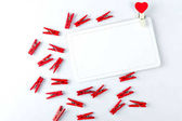 Love card concept. Clothespin with heart on a white background. Valentines day.