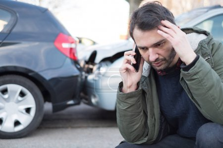 Photo for Man calling first aid after car crash accident - Royalty Free Image