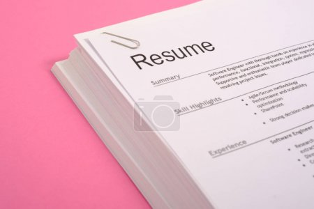 Equal opportunities career concept.Pile of cv isolated on pink background