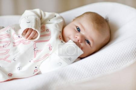 Cute adorable newborn baby againgst white backgrou...