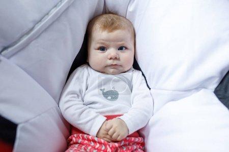 Close-up portrait of adorable newborn baby. New bo...
