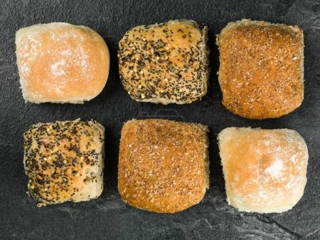 Selection of Six Mixed Bread Rolls or Buns Against...