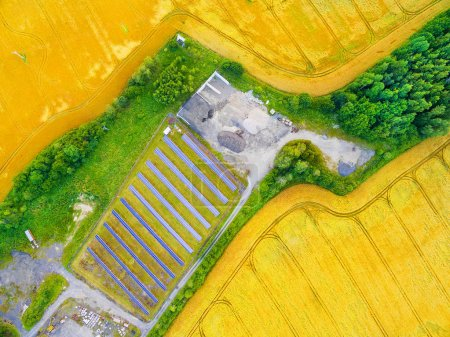Aerial view to solar power plant in agricultural landscape