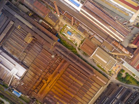Aerial view of steelworks with rusty roofs