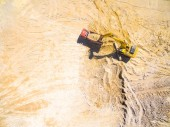 Aerial view of a excavator and truck in the mine. Industrial background on mining theme.
