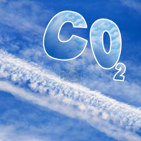 Symbol of carbon dioxide on blue sky with aircraft trails