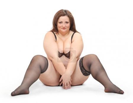 Overweight woman dressed in underwear
