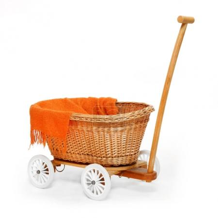Rustic baby pram on white background.