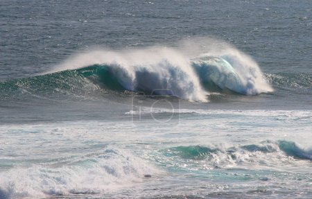 Indian Ocean wave breaking on rocks