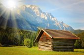 Hayloft in alpine landscape.