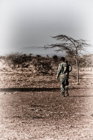 Photo for Africa  in the land of ethiopia a black soldier  and his gun looking the boarder - Royalty Free Image