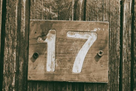 in cyprus in the old door the number seventeen in a rusty and dirty plate concept of