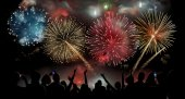 Holiday Celebration with fireworks show at night silhouette of people watching a festive fireworks display vector background