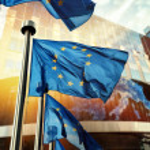 EU flags waving in front of European Parliament bu...