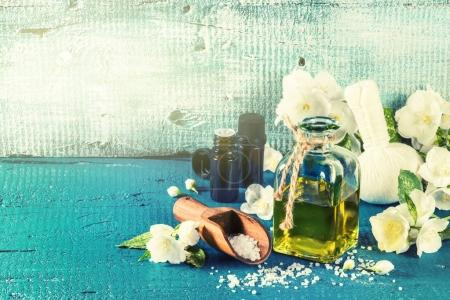 Spa setting with jasmine flowers and essential oil