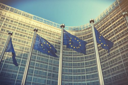 EU flags waving in front of European Commission building. Brussels, Belgium
