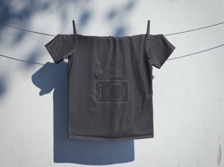 Blank black t-shirt on a rope near wall. 3d rendering