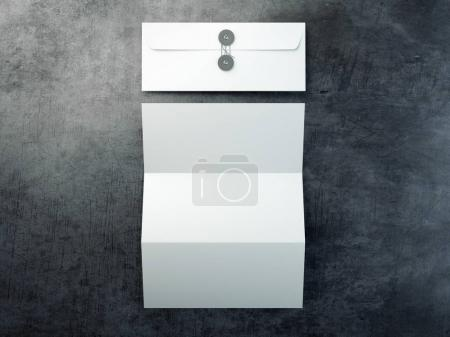 Blank leaflet and white envelope. 3d rendering