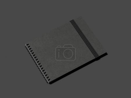Black notebook with blackrubber band. 3d rendering