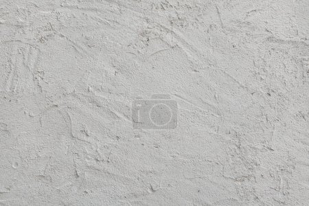 Pattern of white painted stucco wall