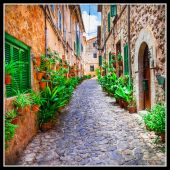 Charming old streets of Italian villages  decorated with flowers