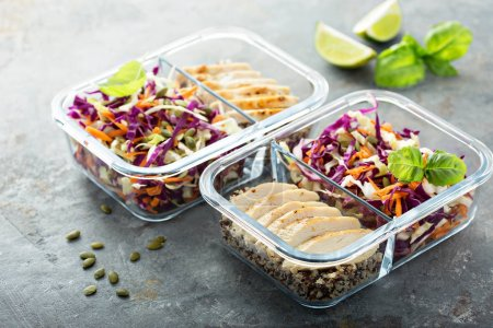 Photo for Healthy meal prep containers with quinoa, chicken and cole slaw - Royalty Free Image