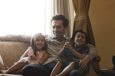 Happy father and children