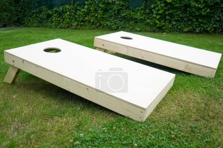 Photo for Cornhole Boards Outdoors in Garden - Royalty Free Image