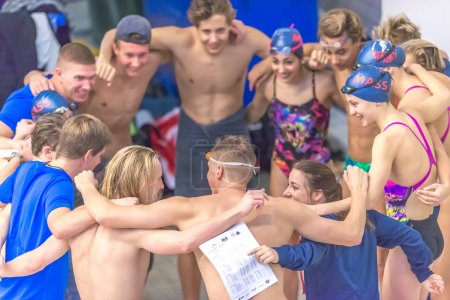 Group hug at the National Swedish swim competition at Eriksdalsb