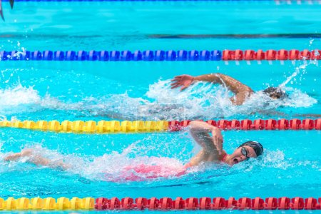 Swimmers crawling at the National Swedish swim competition at Er