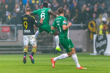 Pa Dibba jumping for a header at the derby game between AIK and