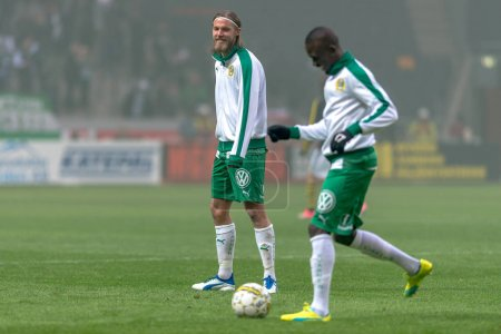 Hammarby players warming up for the second half at the derby gam