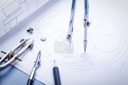 Photo for Compass drawing a circle on the drawing. Part of the industrial project. selective focus - Royalty Free Image