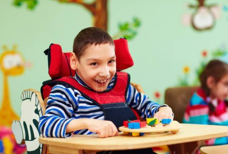 Photo for Cheerful boy with disability at rehabilitation center for kids with special needs - Royalty Free Image