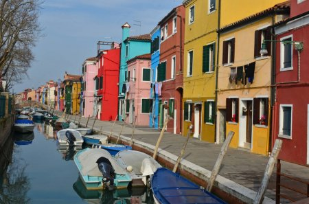 Canal with boats lined by colourful houses