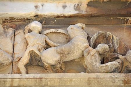 Ancient Greek carvings of the symbolic battle betw...