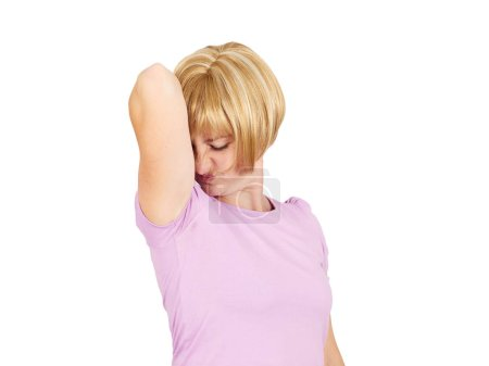 Photo for Young woman, smelling, sniffing her wet armpit, something stinks, very bad foul odor situation isolated . Negative emotion facial expression reaction - Royalty Free Image