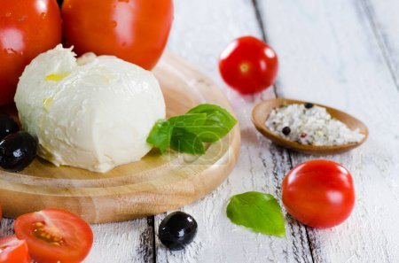Fresh tomatoes, mozzarella and basil, ingredients for salad