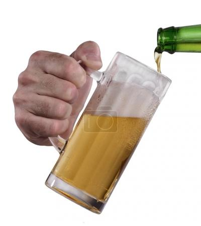 Male hand holding a glass of beer