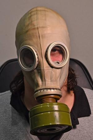 Man in toxic gas mask