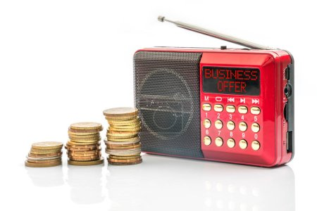 Red radio with text on screen. Marketing and busin...
