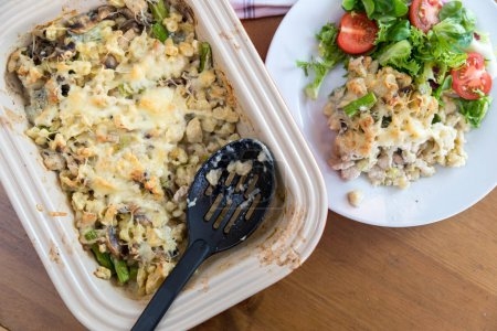 homemade baked dish with chicken meat, mushrooms, asparagus and cheese