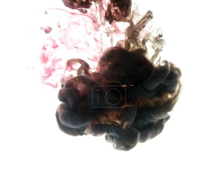 Photo for Colors dropped into liquid and photographed while in motion. Cloud of silky ink in water on white isolated background, an abstract banner. - Royalty Free Image