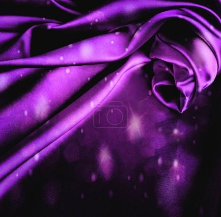 Glare violet satin background.