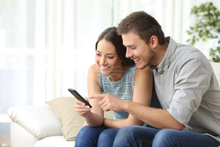 Couple or friends using a mobile phone
