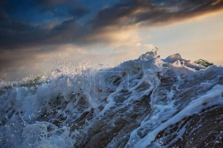 Photo for Shorebreak wave crushing with water drops at sunset time - Royalty Free Image